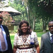 Three people - Lucy Dzandu, Simon Osei and Benjamin Folitse from the Ghana CSIR-INSTI institutional repository implementation team - standing in a garden in Addis Ababa.