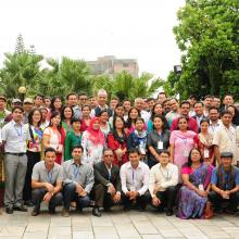 Group photo of seminar participants in the grounds of Hotel Shanker