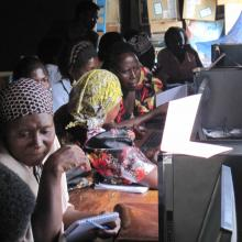 Women farmers learning how to use computers.