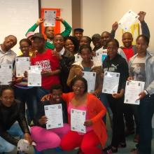 The library's 2012 intermediate computer and job readiness trainees celebrate their graduation.