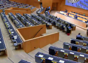 Scene from nearly empty hall during SCCR/40 in 2020 which took place in hybrid mode, with only Geneva-based delegates present, and everyone else participating remotely because of COVID-19.