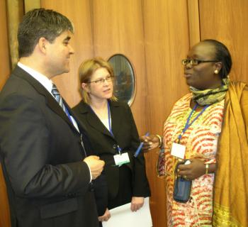 Awa Cissé, EIFL copyright librarian from Senegal, debates copyright with two other delegates at WIPO.