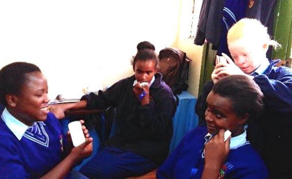 Visually impaired schoolchildren using DAISY (digital audio) devices in Nairobi Area Library.