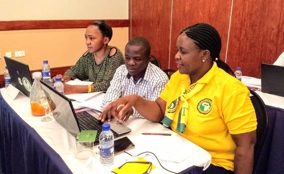 Three Zambian librarians at training, learning about ICT.